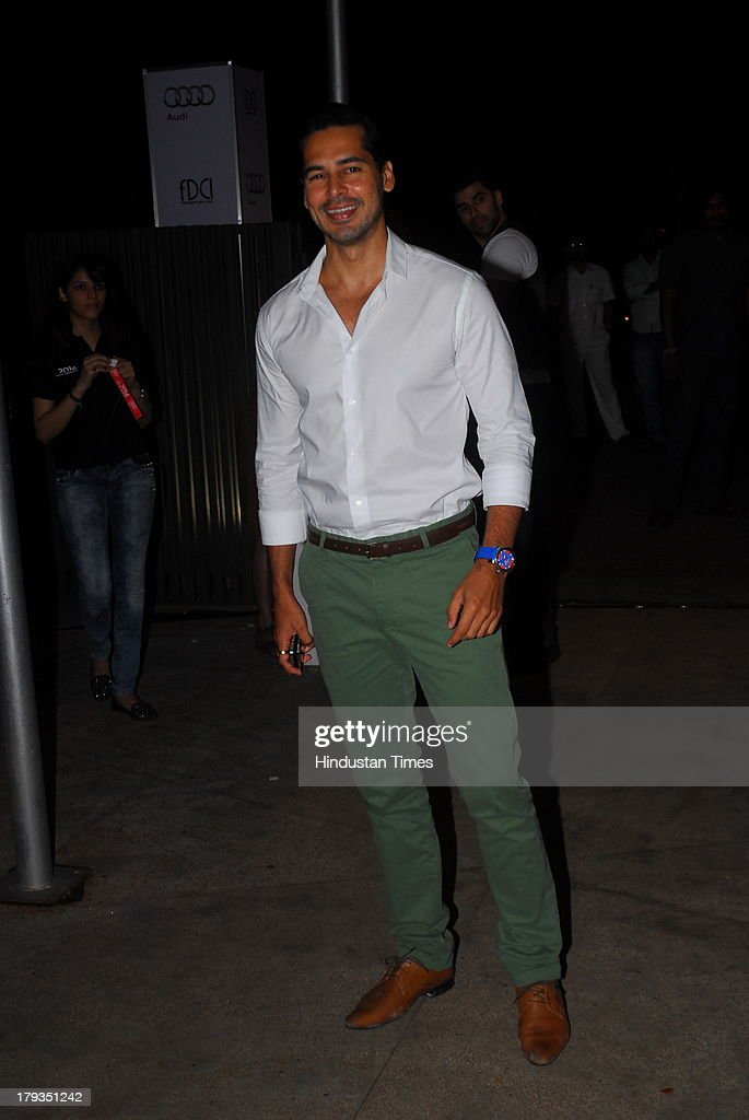Bollywood actor Dino Morea during FDCI and Audi India's winter collection at Tote, Mahalaxmi Race Course on August 30, 2013 in Mumbai, India.