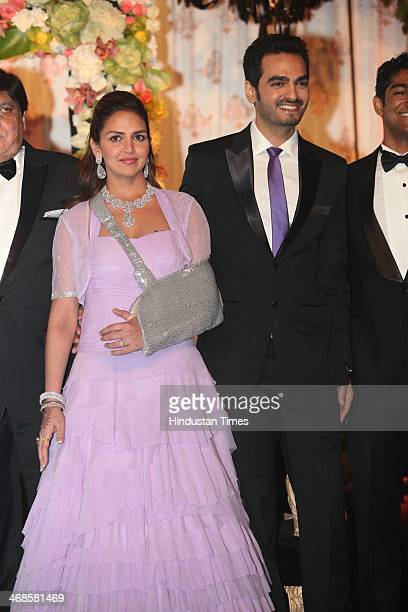 Bollywood actor Esha Deol with her husband Bharat Takhtani during the wedding reception of her sister Ahana Deol and Vaibhav Vohra on February 5 2014...