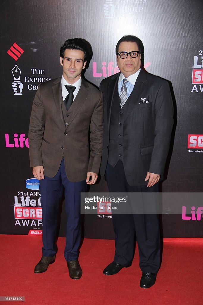 Bollywood actor Girish Kumar and producer <a gi-track='captionPersonalityLinkClicked' href=/galleries/search?phrase=Ramesh+Taurani&family=editorial&specificpeople=6136061 ng-click='$event.stopPropagation()'>Ramesh Taurani</a> (R) during the 21st Annual Life OK Screen Awards at Bandra Kurla Complex on January 14, 2015 in Mumbai, India.