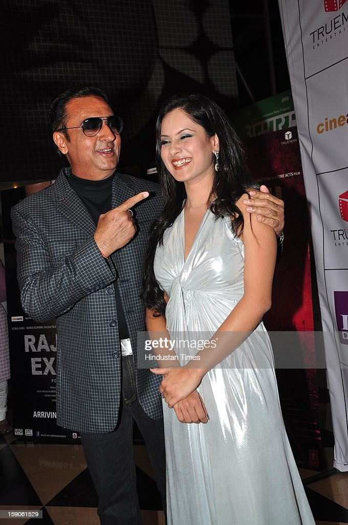 Bollywood actor Gulshan Grover with Pooja Bose pose during premiere of their upcoming film Rajdhani Express: Point Blank Justice at PVR, Juhu on December 3, 2013 in Mumbai, India.