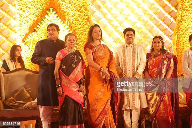 Bollywood actor Hema Malini poses with Union Minister Nitin Gadkari his wife Kanchan Gadkari and their newlywed daughter Ketki and soninlaw Aditya...