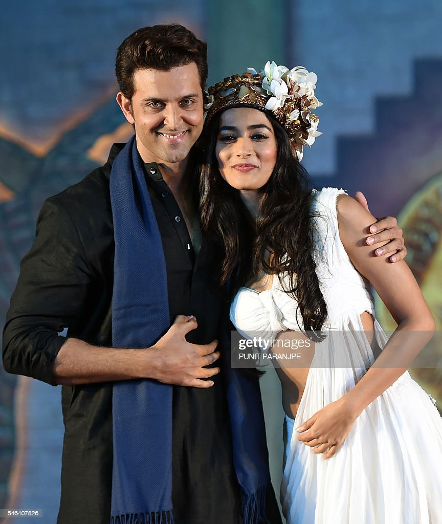 http://media.gettyimages.com/photos/bollywood-actor-hrithik-roshan-poses-with-actress-pooja-hegde-during-picture-id546407826