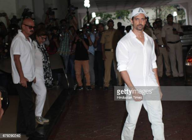 Bollywood actor Hrithik Roshan with his father Rakesh Roshan during the prayer meeting organised for the late Bollywood veteran Vinod Khanna at Worli...