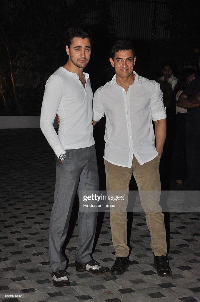 Bollywood actor Imran Khan with Aamir Khan during his house warming party on December 22, 2012 in Mumbai, India.