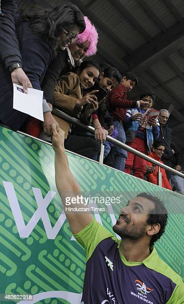 Bollywood actor John Abraham meets with people during a match between Delhi Waveriders and Dabang Mumbai during the Hero Hockey India League at Major...