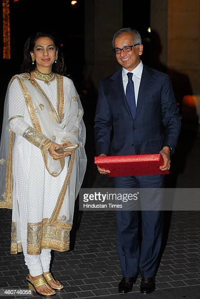 Bollywood actor Juhi Chawla with her businessman husband Jay Mehta during wedding ceremony of Riddhi Malhotra and Tejas Talwalkar on December 15 2014...