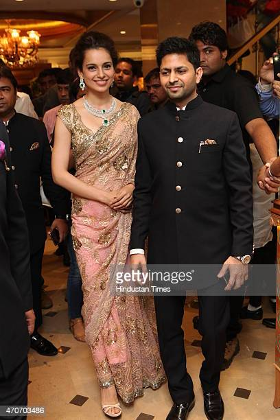 Bollywood actor Kangana Ranaut and Praveen Goel CMD Sunar during the launch of Sunar Jewelry on April 20 2015 in New Delhi India