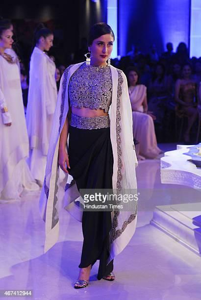 Bollywood actor Kareena Kapoor Khan walks the ramp displaying outfits by designer Annamika Khanna at the Lakme Fashion Week Summer Resort 2015 on...