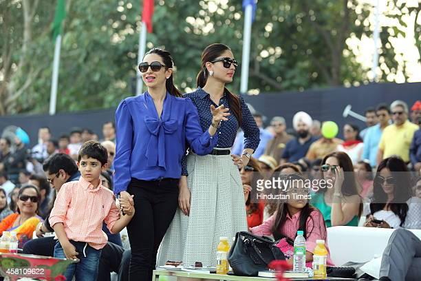 Bollywood actor Kareena Kapoor with her sister Karisma Kapoor and her children Samiera and Kiaan Raj during Bhopal Pataudi Polo Cup 2014 at the...