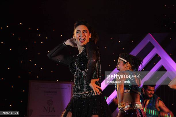 Bollywood actor Lauren Gottlieb performs during the Swarovski Gemstones National Jewellery Awards 201516 on February 6 2016 in Mumbai India