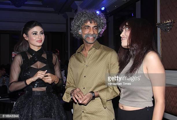 Bollywood actor Makarand Deshpande with his wife Nivedita Pohankar and TV actress Mouni Roy during Hindustan Times Most Stylish Awards 2016 at Taj...