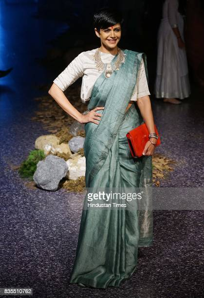 Bollywood actor Mandira Bedi walks on the ramp during the Lakme Fashion Week 2017 at Royal Opera House on August 17 2017 in Mumbai India