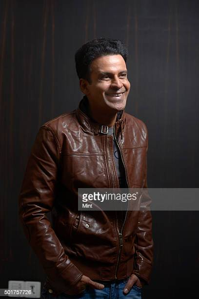 Bollywood actor Manoj Bajpai poses for a profile shoot for an interview at his house on November 19 2015 in Mumbai India