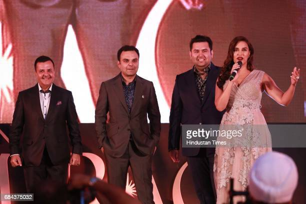Bollywood actor Neha Dhupia Rakesh Kapoor Elan Group Chairman with Directors Akash Kapoor and Ravish Kapoor during the launch of prestigious project...