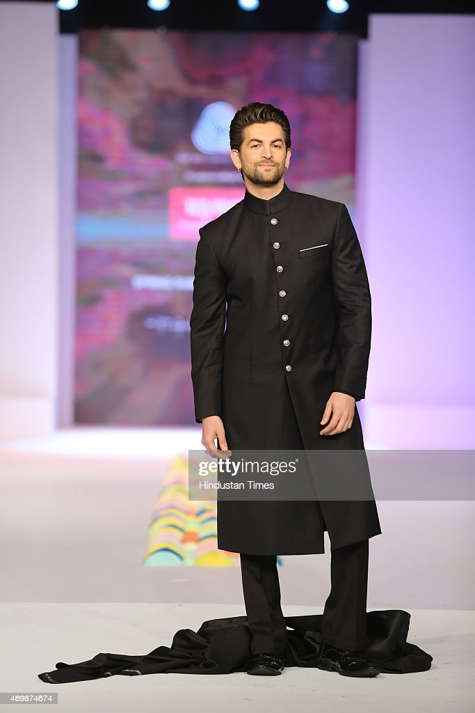 Bollywood actor <a gi-track='captionPersonalityLinkClicked' href=/galleries/search?phrase=Neil+Nitin+Mukesh&family=editorial&specificpeople=5642805 ng-click='$event.stopPropagation()'>Neil Nitin Mukesh</a> walks on the ramp during the fashion party hosted by Australian High Commissioner Patrick Suckling to welcome Julie Bishop, Australias Minister for Foreign Affairs at the Australian High Commission, on April 13, 2015 in New Delhi, India. Fashion designers Rajesh Pratap Singh, Timothy Everest and Suket Dhir showcased their latest collection, with actor <a gi-track='captionPersonalityLinkClicked' href=/galleries/search?phrase=Neil+Nitin+Mukesh&family=editorial&specificpeople=5642805 ng-click='$event.stopPropagation()'>Neil Nitin Mukesh</a> as the showstopper.