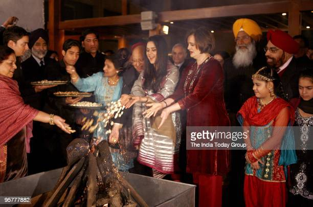Bollywood actor Preity Zinta and Cherie Blair wife of former UK PM Tony Blair attend the Lohri festival organised by the Loomba Trust in the Foreign...