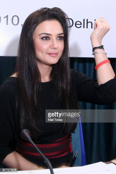 Bollywood actor Preity Zinta reacts at a press conference to announce her joining UNAIDS as a goodwill ambassador in New Delhi on March 11 2010
