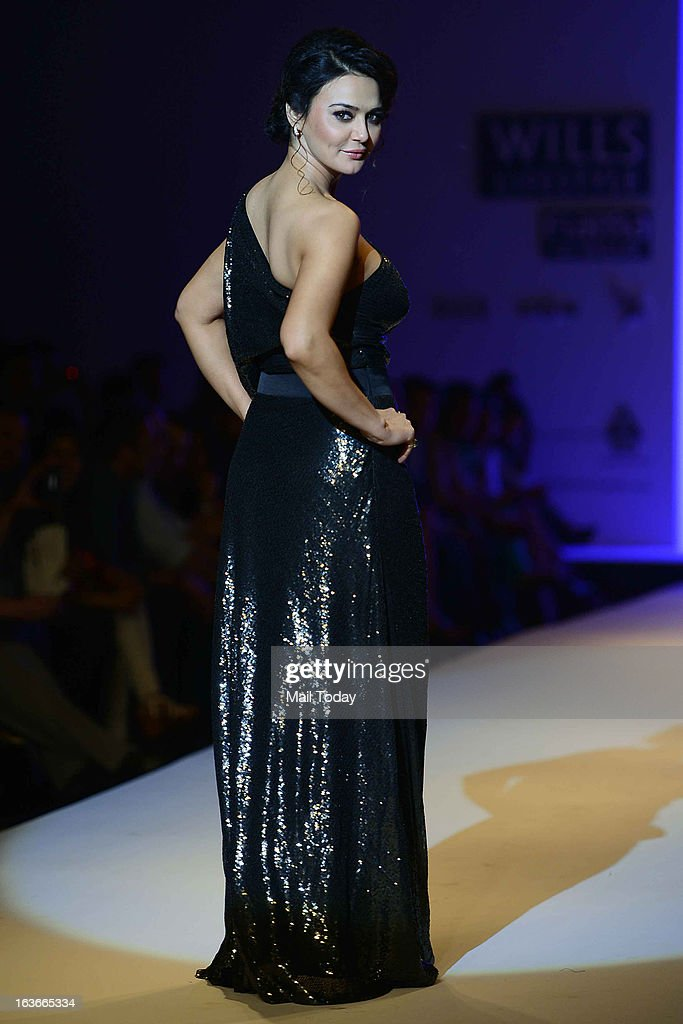 Bollywood actor Preity Zinta showcases a creation by designer Surily at Wills Lifestyle India Fashion Week in New Delhi on March 13, 2013.
