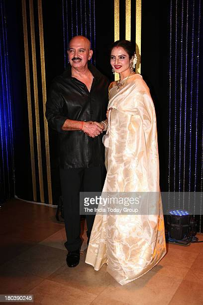 Bollywood actor Rakesh Roshan with actress Rekha at his 64th birthday celebrations at Blue Sea Worli Seaface on September 6 2013 in Mumbai