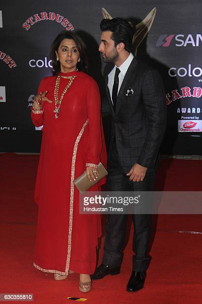 Bollywood actor Ranbir Kapoor along with his mother Neetu Singh poses for shutterbugs during the Sansui Colors Stardust Awards 2016 on December 19...