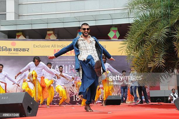 Bollywood actor Ranveer Singh dances to the tunes of victory song 'Malhari' from his film Bajirao Mastani during the promotion of his upcoming film...