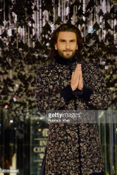 Bollywood actor Ranveer Singh walks for Manish Malhotra during FDCI's India Couture Week 2017 at the Taj Palace hotel on July 30 2017 in New Delhi...