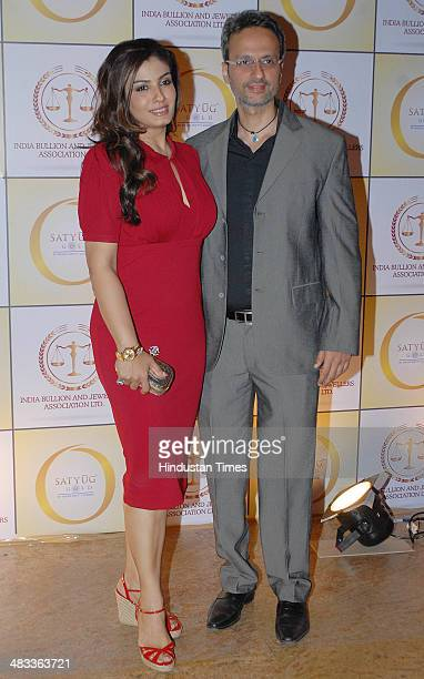 Bollywood actor Raveena Tandon with husband Anil Thadani during the launch of Satyug Gold in association with the India Bullion Jewellery Association...