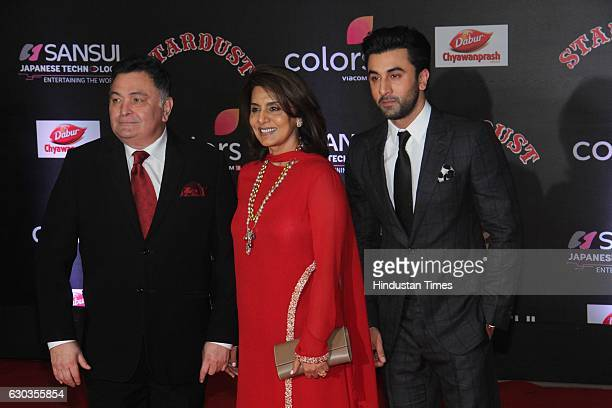 Bollywood actor Rishi Kapoor along with his wife Neetu Singh and son Ranbir Kapoor poses on red carpet for shutterbugs during the Sansui Colors...