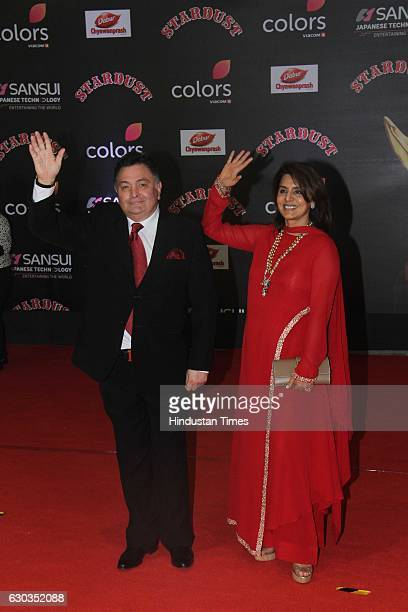 Bollywood actor Rishi Kapoor along with his wife Neetu Singh poses on red carpet for shutterbugs during the Sansui Colors Stardust Awards 2016 on...