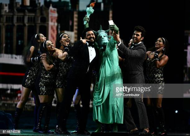 CORRECTION Bollywood actor Ritesh Deshmukh and Bollywood actor Manish Paul perform on stage during IIFA Rocks July 14 2017 at the MetLife Stadium in...