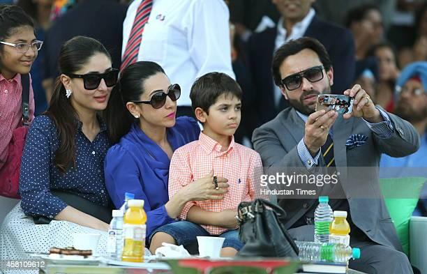Bollywood actor Saif Ali Khan clicking a selfie with his wife Kareena Kapoor sisterinlaw Karisma Kapoor and her children Samiera and Kiaan Raj during...