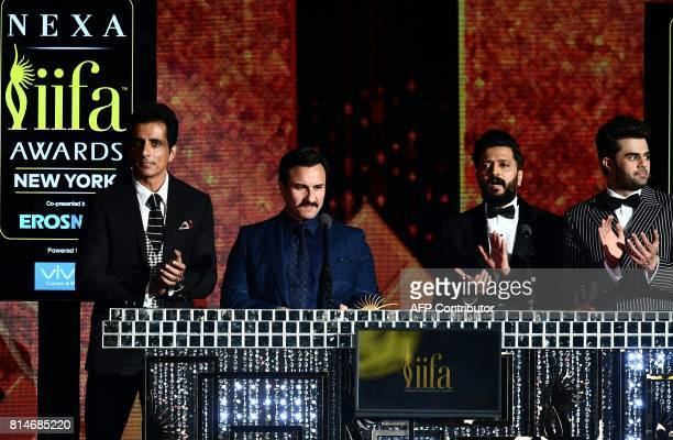 CORRECTION Bollywood Actor Saif Ali Khan speaks on stage as Bollywood actor Ritesh Deshmukh and Bollywood actor Manish Paul look on during IIFA Rocks...