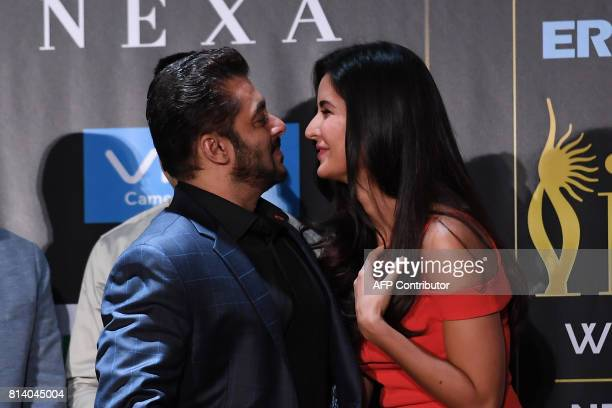 Bollywood actor Salman Khan greets actress Katrina Kaif during a press conference ahead of the 18th International Indian Film Academy Festival in New...