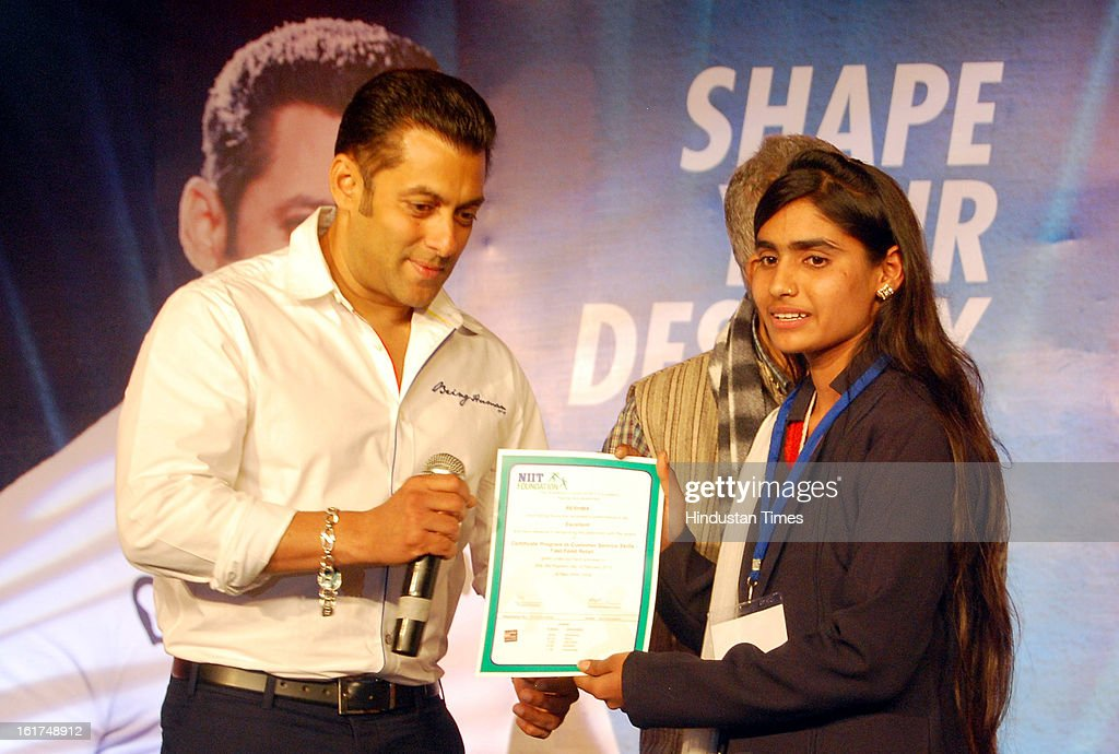 Bollywood actor <a gi-track='captionPersonalityLinkClicked' href=/galleries/search?phrase=Salman+Khan+-+Actor&family=editorial&specificpeople=558807 ng-click='$event.stopPropagation()'>Salman Khan</a> in Sector 63 to distribute certificates to students who passed from Career Development Centre, on February 15, 2012 in Noida, India. Hindustan Coca-Cola Beverages Pvt. Ltd. has partnered with actor <a gi-track='captionPersonalityLinkClicked' href=/galleries/search?phrase=Salman+Khan+-+Actor&family=editorial&specificpeople=558807 ng-click='$event.stopPropagation()'>Salman Khan</a>'s Being Human foundation to empower rural, educated and underserved youth. The initiative, in association with NIIT Foundation and NGO Gram Niyojan Kendra, established its pilot centre near the HCCBPL bottling plant at Dasna in Noida and will branch out to Andhra Pradesh, Karnataka, Maharashtra and Odisha.