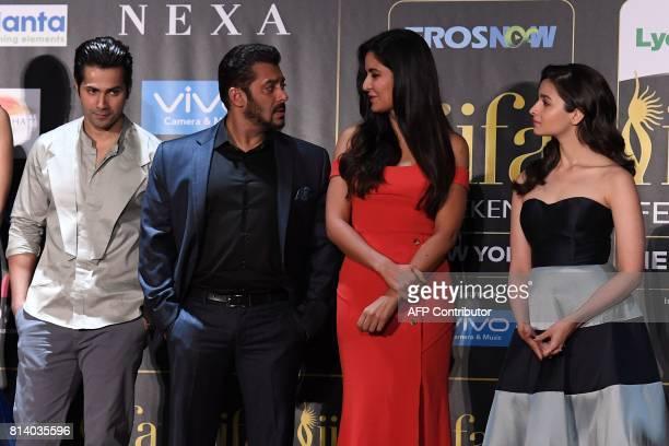 Bollywood actor Salman Khan talks to actress Katrina Kaif and Varun Dhawan and Alia Bhatt look on during a press conference ahead of the 18th...