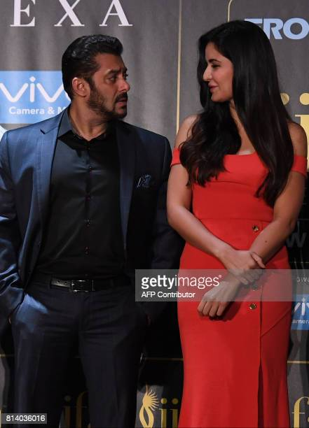 Bollywood actor Salman Khan talks to actress Katrina Kaif during a press conference ahead of the 18th International Indian Film Academy Festival in...