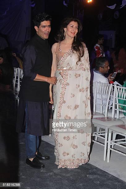 Bollywood actor Sangeeta Bijlani with fashion designer Manish Malhotra during the opening show of Lakme Fashion Week Summer/Resort 2016 at Mehboob...