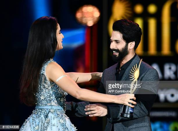 Bollywood Actor Shahid Kapoor accepts his award for Best Actor from Katrina Kaif on stage during the IIFA Awards July 15 2017 at the MetLife Stadium...