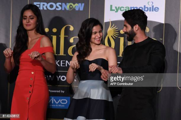 Bollywood actor Shahid Kapoor Alia Bhatt and Katrina Kaif dance during a press conference ahead of the 18th International Indian Film Academy...