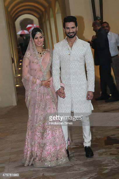 Bollywood actor Shahid Kapoor with his wife Mira Rajput poses for his first photo op post wedding on July 7 at Hotel Trident on July 7 2015 in...