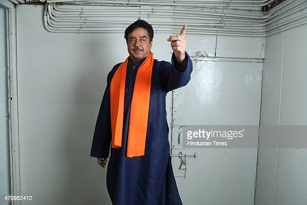 Bollywood actor Shatrughan Sinha poses for photographers before his onstage comic play Pati Patni aur Main on April 19 2015 in New Delhi India