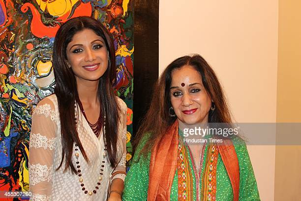 Bollywood actor Shilpa Shetty with journalist Nalini Singh at filmmaker Anu Malhotra's debut art show Hue Borne at Visual Arts Gallery India Habitat...