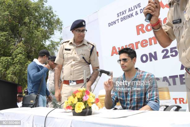 Bollywood actor Siddharth Malhotra along with DCP Traffic AK Singh and school children participates during a Delhi road safety activity to spread...