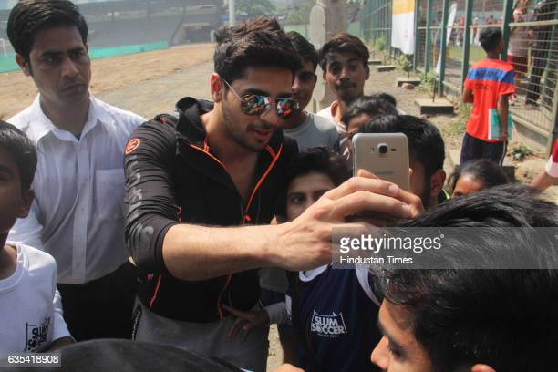 Bollywood actor Sidharth Malhotra clicking selfie with kids during an inauguration of the National Inclusion Cup 2017 at the Andheri Sports Complex...