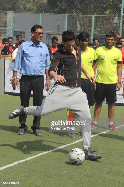 Bollywood actor Sidharth Malhotra playing football during an inauguration of the National Inclusion Cup 2017 at the Andheri Sports Complex on...