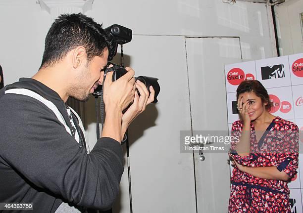 Bollywood actor Sidharth Malhotra tried his hand at photography clicking pictures of Alia Bhatt at Coke studio season 4 press conference at Villa 69...