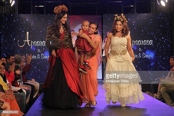 Bollywood actor Sonal Chauhan and RJ Malishka walk the ramp for 'Applause for Cause' a fund raising fashion show for an NGO called Access Life that...