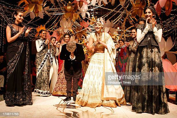 Bollywood actor Sonam Kapoor walks on the ramp with Indian fashion designer Rohit Bal during the Indian Bridal Fashion Week 2013 held at The Grand on...