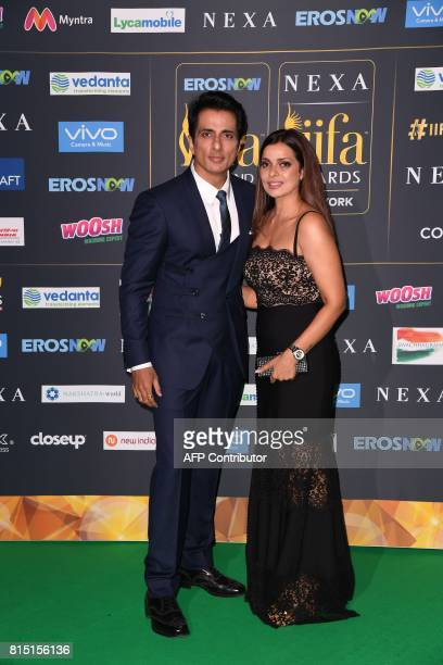 Bollywood actor Sonu Sood arrives with a guest for the IIFA Awards July 15 2017 at the MetLife Stadium in East Rutherford New Jersey during the 18th...
