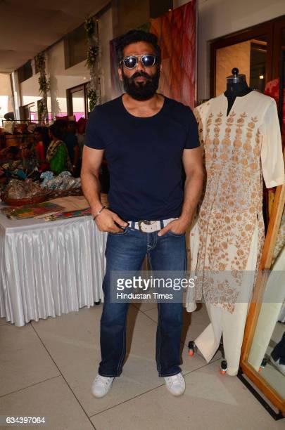 Bollywood actor Suniel Shetty during a Charity exhibition Araaish organised by Mana Shetty wife of actor Suniel Shetty at Blue Sea Worli on February...